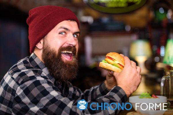 homme affamé qui mange du gras